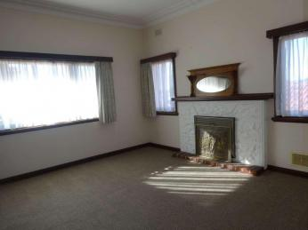 Spacious Character Home with Decorative Ceilings, Polished Floorboards, Feature Glass Doors and an Old Fire Place